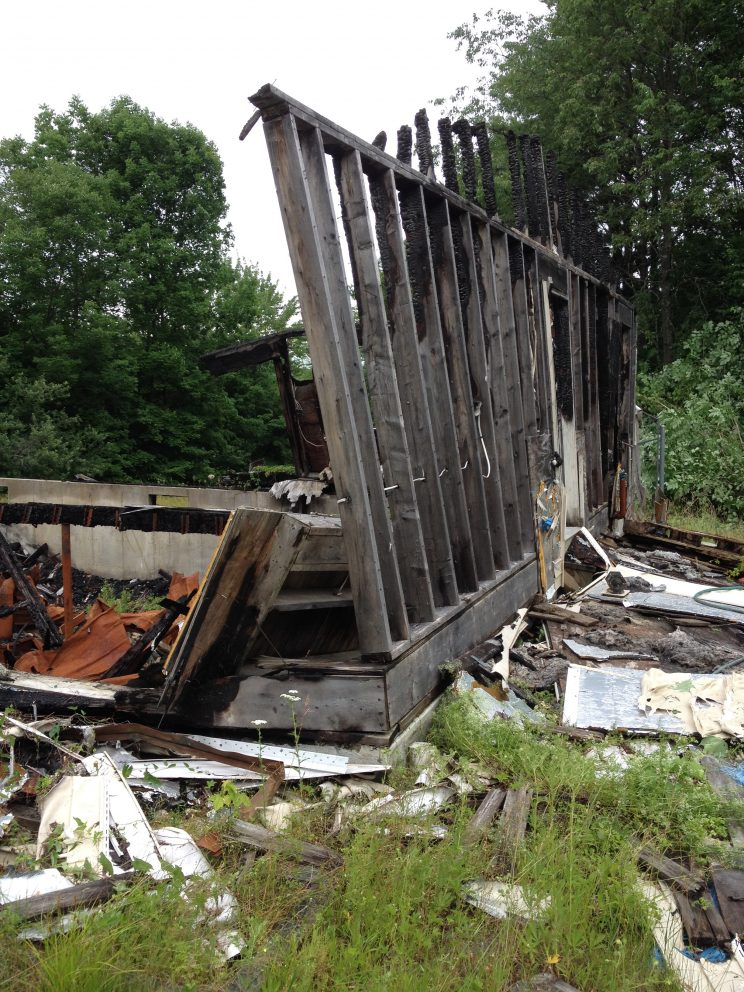 picture of the old burnt house in the homestead property tour
