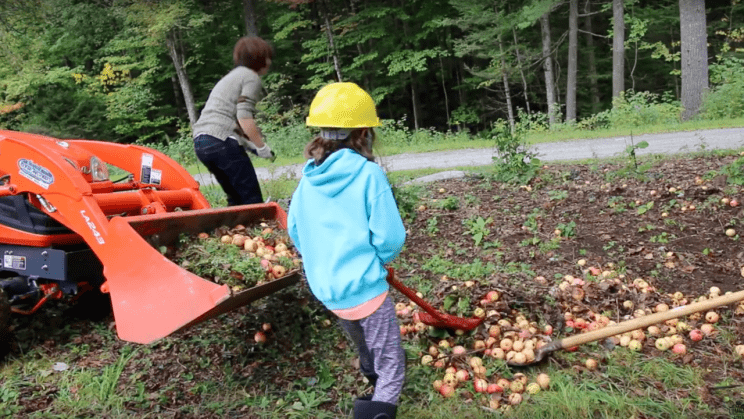 Olivia picking up apples with Mom