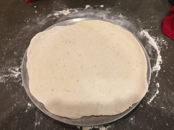 Pizza Dough on cooking sheet