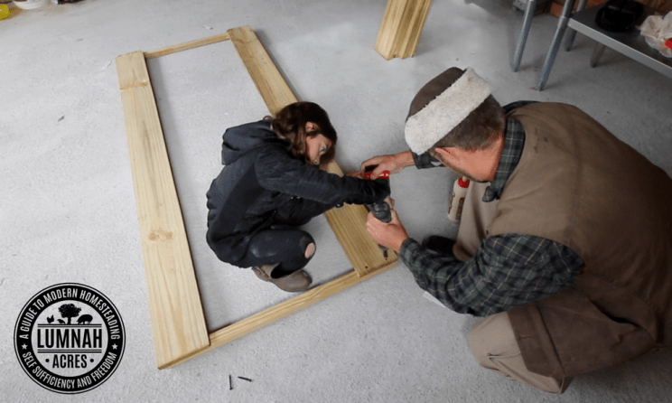 Attaching the Pickets to the Spindles to make the sides of the $30 Chicken coop